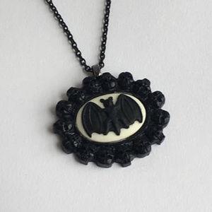 Jewelry - Black bat on white cameo in skull frame